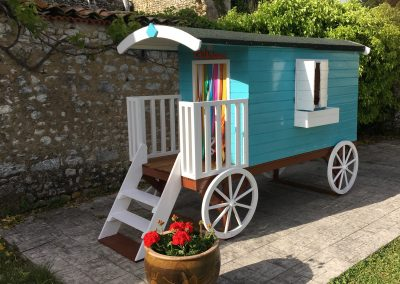 New in 2018, a gypsy caravan-style playhouse located in the swimming pool area.
